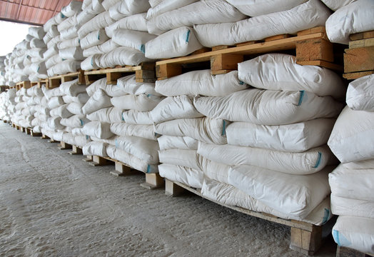 Long rows of pallets with bags.