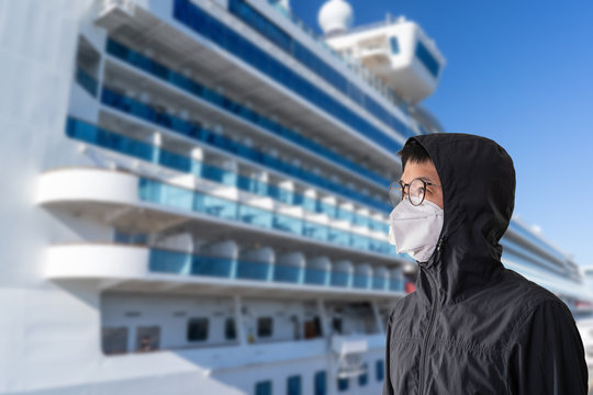 Asian man wearing surgical mask to prevent flu disease Coronavirus with blurred image of cruise ship