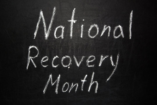 National Recovery Month written in white chalk on a black chalkboard