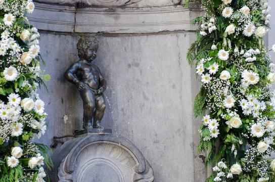 Famous statue of Manneken Pis (pissing boy) in Brussels