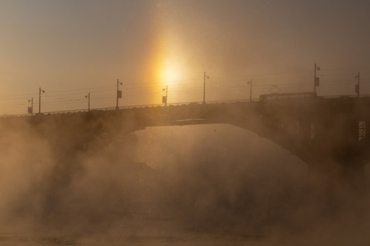 Solar halo over the bridge over the Angara