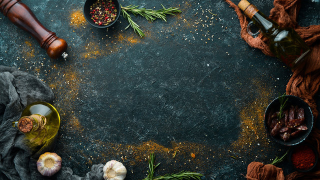 Black stone cooking banner. Spices and herbs. Top view.