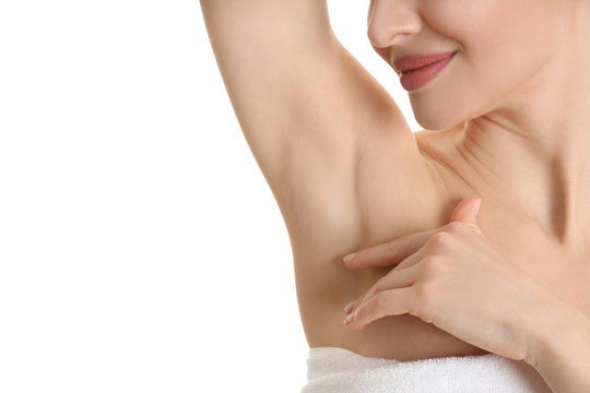 Young beautiful woman showing armpit with smooth clean skin on white background, closeup