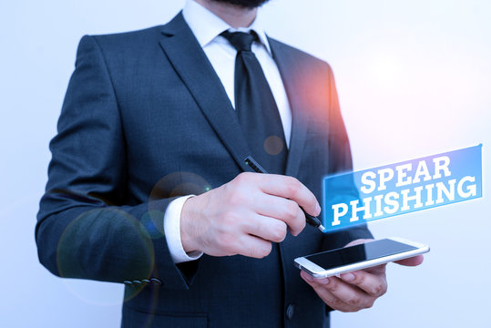 Text sign showing Spear Phishing. Business photo text Sending fake emails to extract financial data from user Male human wear formal work suit hold smart hi tech smartphone use one hand