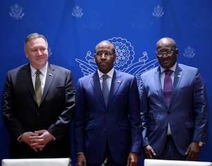 Senegal's Minister of Economy, Planning and International Cooperation Amadou Hott and U.S. Secretary of State Mike Pompeo wait for signing of a memorandum of understanding (MOU) during a meeting with business leaders in Dakar