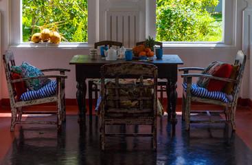 veranda of an old Dutch Villa with vintage furniture and tropical garden, Sri Lanka Asia