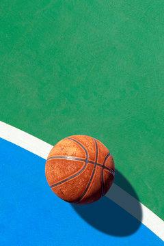 sport concept. old basketball on court. over light