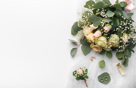 Wedding stylish bouquet of tender cream roses on white