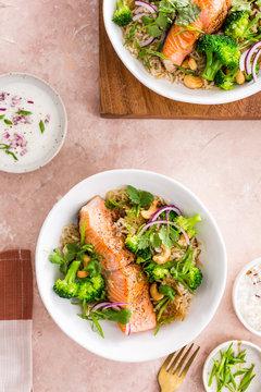 Delicious salmon with broccoli, coriander, cashews, brown rice and yogurt sauce