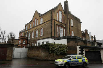 A police vehicle drives past the apartment which is believed to belong to British television presenter Caroline Flack, in north London
