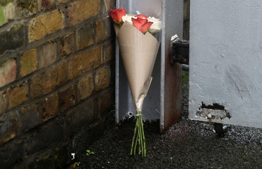 Flowers lie outside the apartment which is believed to belong to British television presenter Caroline Flack, in north London