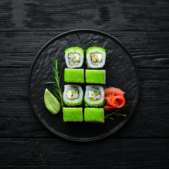 Green Sushi Rolls - With Tobiko Green Caviar and Shrimp. Traditional Japanese cuisine. Top view.