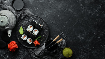 Sushi rolls -Fila Black with black caviar, salmon and cheese. Top view. Free space for your text.