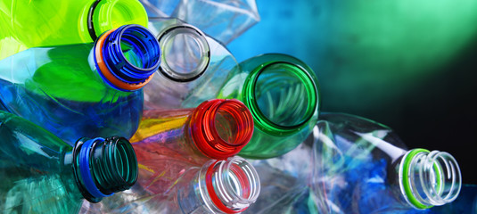 Fototapeta Empty colored carbonated drink bottles. Plastic waste