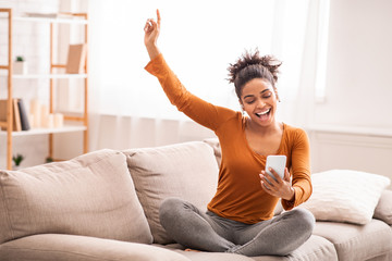 Afro Woman Listening To Music Singing Sitting On Sofa Indoor Fotobehang