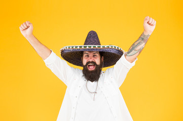 Mexican energetic temper. Celebrate traditional mexican holiday. Cinco de Mayo. Mexican Day of Dead. 5th of May. Lets have fun. celebrate fiesta. happy man in mexican sombrero. A souvenir straw hat Wall mural