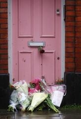 Flowers lie outside British television presenter Caroline Flack's old house in Islington, London