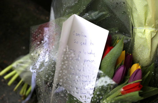Flowers and a card are seen outside British television presenter Caroline Flack's old house in Islington, London