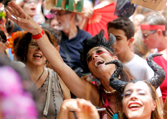 """Reveller stake part in the annual block party known as """"Gigantes da Lira,"""" during Carnival festivities in Rio de Janeiro"""