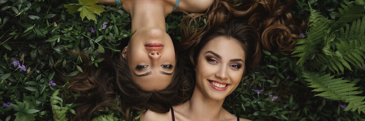 Spring beauty or woman natural cosmetics concept. Fashion portrait photo of two women