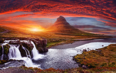 Fototapeta Scenic image of Iceland. Incredible Nature scenery during sunset. Great view on famous Mount Kirkjufell with Colorful, dramatic sky. popular plase for photografers. Best famous travel locations obraz