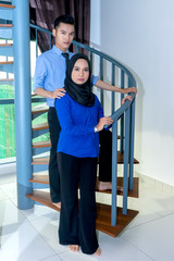 Two young office worker staff posing at the stair.