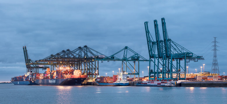 ANTWERP-JULY 15, 2019. Illuminated container terminal at twilight. The Port of Antwerp in Flanders, Belgium is the second-largest seaport of Europe, after Rotterdam in the Netherlands.