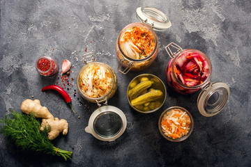 Different fermented vegetables, kimchi, sauerkraut in glas jars, marinated canned food, natural probiotics, healthy eating, prebiotic rich food for digestion, weight loss and immunity boost