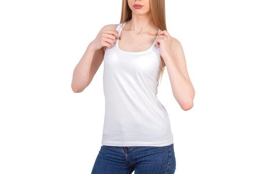 Girl in white t-shirt poses against white background