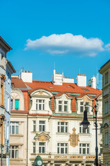 Wall Murals View of the top of old buildings with red roof and blue sky at Prague city Czech republic.