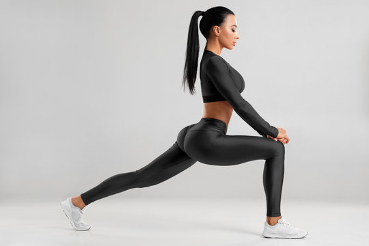 Fitness woman doing lunges exercises for leg muscle workout training. Active girl doing front forward one leg step lunge exercise for butt, isolated