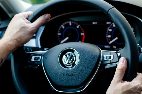 Soest, Germany - August 4, 2019: Close up of hands of driver on steering wheel of car.