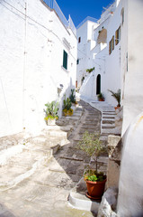 Narrow streets of the town of Ostuni with white buildings in Puglia Apulia region, Southern Italy