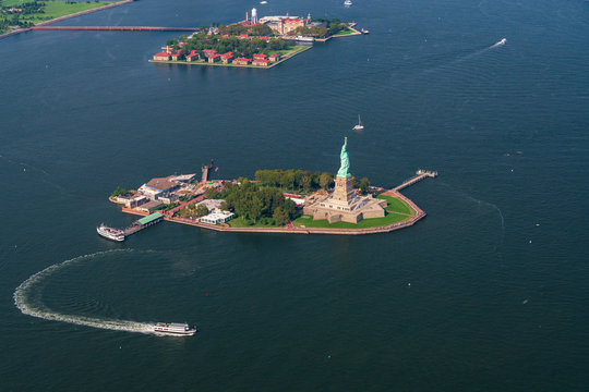 An Aerial photograph of the Statue of Liberty and Liberty Island. Ellis Island is in the background
