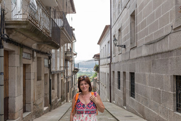 Portrait of a mature woman on a walk in Tui, Galicia, Spain