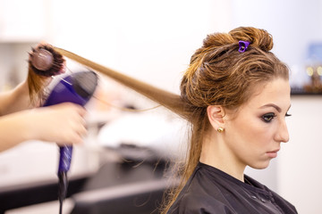 Beautiful young girl at the hairdresser