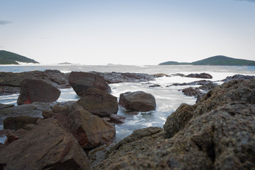 A photo of the rocks and waves at Nelson bay, New South Wales taken in the evening