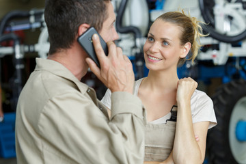 woman talking to colleague in warehouse