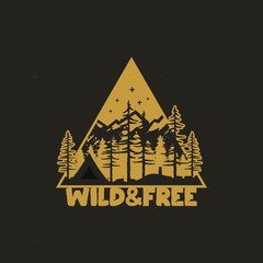 Hand drawn travel badge with camp tent, mountains, pine trees forest and quote - Wild and Free. Old style adventure emblem in retro silhouette colors style. Stock wanderlust patch