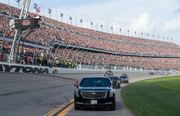 US President Donald Trump and First Lady Melania Trump ride in the Presidential limousine as they take a pace lap ahead of the start of the Daytona 500 Nascar race at Daytona International Speedway in Daytona Beach