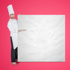 Handsome chef showing empty board