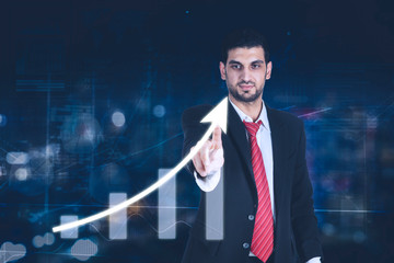 Young businessman touching arrow up on interface screen