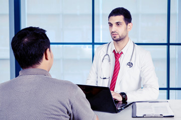 Young doctor talking with his patients