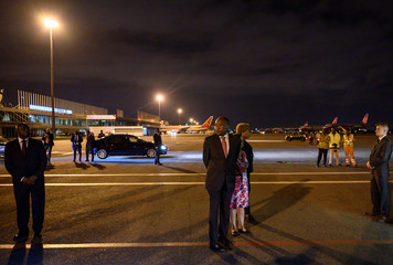 Angolan Foreign Minister Manuel Domingos Augusto waits for the arrival of U.S. Secretary of State Mike Pompeo at 4 de Fevereiro International Airport in Luanda
