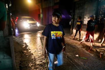 Lea Reyes Cabrera, 51, a member of a volunteer group of women patrollers, is photographed while on duty in Pateros