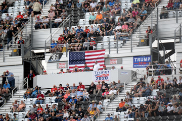 American and Trump flags are displayed at the NASCAR Daytona 500 in Daytona Beach