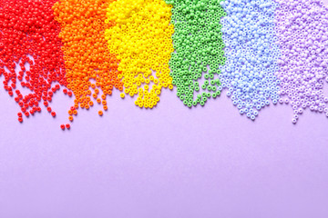 Many beads on color background. LGBT concept
