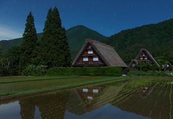 Fototapete - Historic Village of Shirakawa-go at night in Japan in Springtime