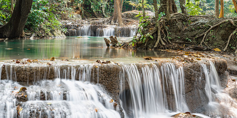 Fototapeta Wide rapids of a mountain waterfall