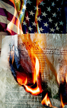 American flag with burning constition